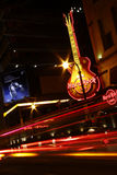 Exciting Atlanta - Hard Rock Cafe at Night. A shot of traffic at night lends an extra sense of motion and energy as it passes the Hard Rock Cafe in downtown stock photography