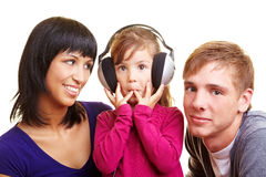Exciting audio book. Girl with headphones listening to an audio book Stock Image