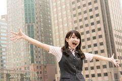 Exciting business woman. Raised hand in outside of city Stock Photography