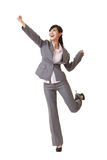 Exciting business woman. Raising hand, full length portrait isolated on white Stock Photo