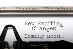 Exciting changes motivational saying. Exciting changes coming soon motivational saying printed on an old typewriter Royalty Free Stock Images