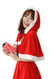 Exciting Christmas girl. With smiling and enjoy face holding gift box over white Stock Images