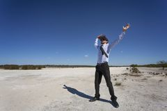 Exciting Enhanced Reality. A young business person wearing a VR headset in a desolate environment Royalty Free Stock Images