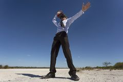 Exciting Enhanced Reality. A young business person wearing a VR headset in a desolate environment Stock Photo