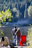 Exciting family fishing on beautiful sunny Trillium lake Royalty Free Stock Photography