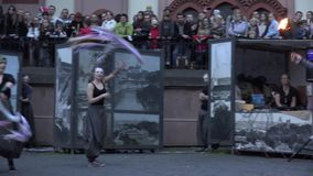 Exciting fire show with young artists dancers and people audience. 4K stock video footage