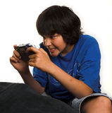 Exciting game. Boy playing an exciting game on a gameboy Stock Image
