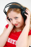 Exciting girl with headset Stock Image