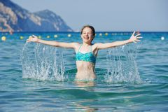 Exciting girl with sea water splashes Royalty Free Stock Photos