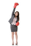 Exciting gloved business woman. On white background Stock Photo