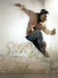 Exciting man. Portrait of man jumping under ray of light stock photos