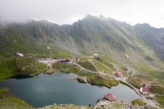 Exciting mountain lake in summer in Romania. Amazing mountain lake in summer in Romania. Balea lake, the place of tourism Stock Images