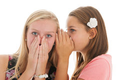 Exciting news. Teen girls are whispering gossip to each other Royalty Free Stock Photo