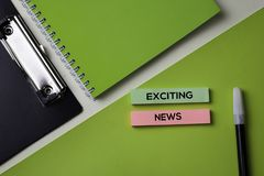 Exciting News text on top view office desk table of Business workplace and business objects royalty free stock image