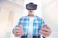 Bristled man looking at transparent tablet through VR headset. Exciting novelty. Pleasant bristled man holding a transparent tablet close to the camera and Royalty Free Stock Photography
