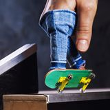 An exciting ride on a mini skateboard or fingerboard on a specially equipped track. Closeup royalty free stock photos