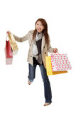 Exciting shopping woman. Of Asian holding bags isolated over white Royalty Free Stock Photos