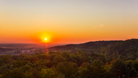 Exciting sunrise over fogged city and park, aerial view, Lviv. Exciting colorful sunrise over fogged morning city and park, aerial view. Lviv, Ukraine Stock Photography