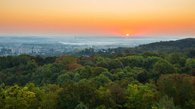Exciting sunrise over fogged city and park, aerial view, Lviv. Exciting colorful sunrise over fogged morning city and park, aerial view. Lviv, Ukraine Royalty Free Stock Image