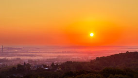 Exciting sunrise over fogged city and park, aerial view, Lviv Stock Images