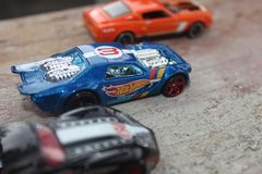 exciting three toy car races stock image