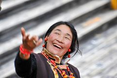 An exciting Tibetan woman,Tibet, China royalty free stock images