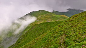 Exciting time-lapse scene of fog moving in the Carpathians mountains. Exciting time-lapse scene of thick fog moving in the fairy Carpathians mountains stock footage