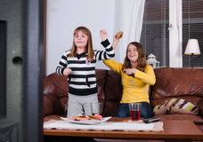 Exciting tv audition. Girls have fun with tv telecast Royalty Free Stock Photo