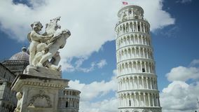 Exciting view of Fountain with Angels and Leaning Tower of Pisa in Italy, tour. Stock footage stock video