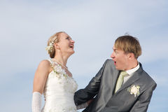 Exciting wedding. Happy bride and groom, cloudy sky background Stock Images