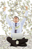 Exciting young businessman raise hands with money Stock Images
