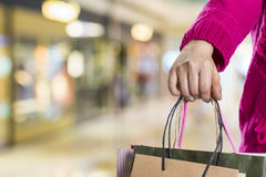 Exciting young shopping woman hold bags. Closeup portrait with copyspace Stock Photo