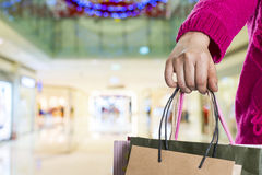 Exciting young shopping woman hold bags. Closeup portrait with copyspace Stock Photography