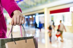 Exciting young shopping woman hold bags. Closeup portrait with copyspace Stock Photos