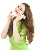Exciting young woman speaking on the phone. White background Stock Photography