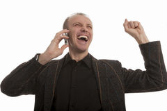 Exclaiming young man speaking on cellphone Royalty Free Stock Photos
