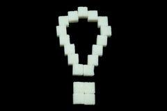 Exclamación del azúcar refinado en el fondo negro Fotos de archivo