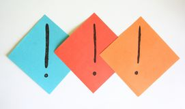 Exclamation mark. Three exclamation marks on papers Royalty Free Stock Photography