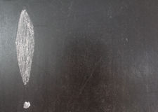 Exclamation mark. Draw left by white chalk on blackboard background royalty free stock photo
