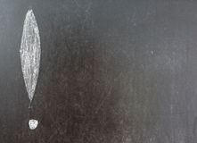 Exclamation mark. Draw left by white chalk on blackboard background Stock Photography