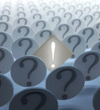 Exclamation mark among question. An exclamation mark among question marks Royalty Free Stock Images