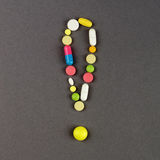 Exclamation point created from colored pills. Medical concept Stock Images