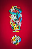Exclamation sign made of pills Royalty Free Stock Images
