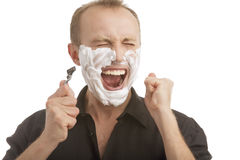 Exclaming while shaving Royalty Free Stock Image