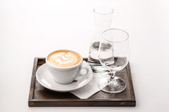 Exclusive art coffee set with glass of water, hot drink product photography, cappuccino, espresso isolated on white background Royalty Free Stock Images
