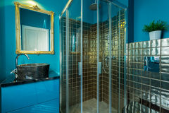 Exclusive bathroom with blue walls royalty free stock image