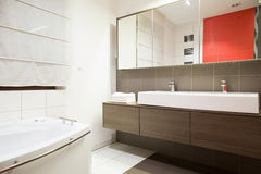 Exclusive bathroom. Image of bright exclusive bathroom with marble floor royalty free stock photo