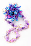 Exclusive bracelet, kusudama and necklace isolated Royalty Free Stock Image