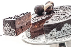 Exclusive chocolate cake with lace, bananas and chocolate ball decoration, patisserie, photography for shop, sweet dessert Stock Images