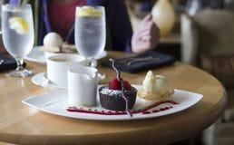 Exclusive desert, chocolate tart with vanilla ice cream Royalty Free Stock Photo